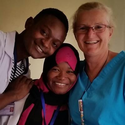 Australian intern on a nursing internship in Tanzania with Proejcts Abroad takes a photo with colleagues during her work experience.